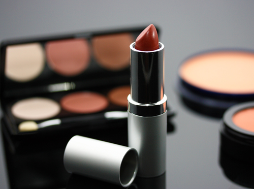 Cosmetics Selection Including Lipstick And Eye Shadow On The Table